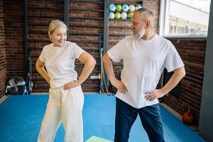 Elderly couple exercising